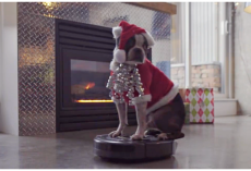 Dog In A Santa Suit Takes A Ride On A Roomba To Kick Off The Holiday Season